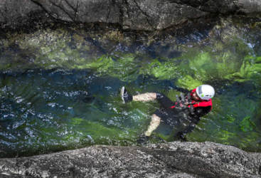 Taking a dip in crystal clear waters at Behana Gorge