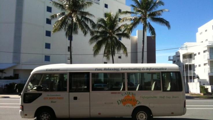 Air-conditioned coach for the afternoon Cairns City tour