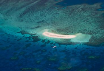 Cairns scenic flight over a Sandy Cay on the Great Barrier Reef in Australia