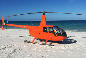 Experience landing on a tropical beach in the Whitsunday Islands.