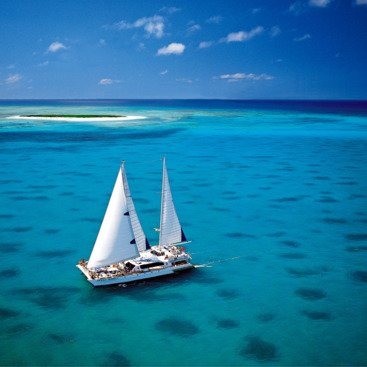 Catamaran at Michaelmas cay