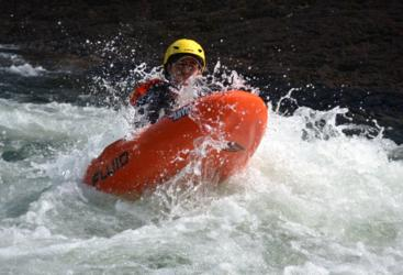 Face first white water river boarding action
